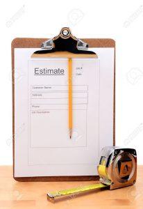 26586804-primer-plano-de-una-contratistas-estimar-formulario-con-un-lápiz-y-cinta-métrica-en-una-mesa-de-madera